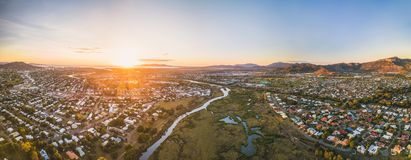 Soft pinkish blue sunrise over Townsville. Aerial footage of a pinkish blue sunrise over the Ross River in Townsville with Castle Hill in the background royalty free stock images