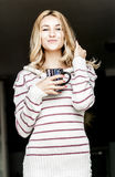 Soft portrait of teenage girl drinking hot coffee at home, instagram style toned Stock Images