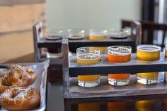 Pretzels and beer flights - bar food royalty free stock images