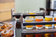 Pretzels and beer flights for game day royalty free stock images
