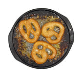 Soft pretzels salted on pan Stock Image