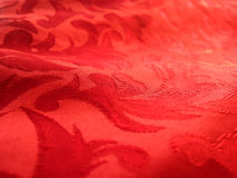 Soft red fabric closeup Stock Photos