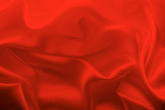 Soft red fabric texture background,crumpled satin backdrop Stock Photo