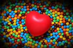 Soft red heart over candy background stock photography
