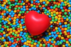 Soft red heart over candy background Royalty Free Stock Photo
