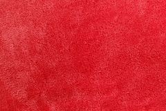 Soft Red Micro Fleece Blanket Background. A pinkish red background of warm, cozy microfleece blanket Royalty Free Stock Photography
