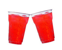 Soft red plastic cups on a white background. Royalty Free Stock Photos