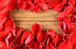 Soft Red rose petals on wooden background Stock Photo