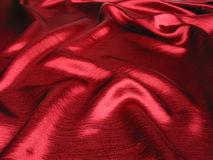Soft red satin background. Soft,reflective red satin background Royalty Free Stock Photo