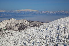 Soft rime and Mt. Gassan in Japan Stock Photo