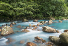 Soft River. Glacier like water races past river rock in Costa Rica Royalty Free Stock Images