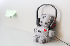 Soft Robot Toy Helpdesk. Soft Robot Toy With Headset at Call Center Royalty Free Stock Photo