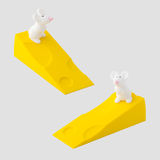 Soft rubber door stopper. In shape of white mouse and bright yellow cheese royalty free stock photography