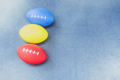 Soft rugby ball for hand exerciser. Over blue wooden surface royalty free stock image