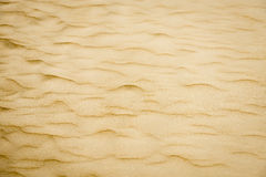 Soft sand textured background. Yellow color. Royalty Free Stock Photography