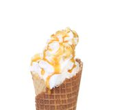 Soft serve ice cream. Topping caramel. Royalty Free Stock Photo