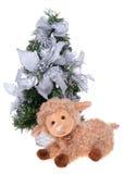 Soft sheep toy near christmas tree Stock Photos