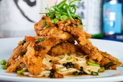 Soft Shell Crab over a bed of noodles Royalty Free Stock Images