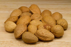 Soft-shelled Almonds on beige background Stock Images