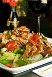 Soft shelled crab. Over greens and peppers Royalty Free Stock Images