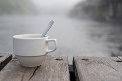 Soft shot of coffee cup. And Blurred fog background Stock Images