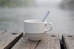 Soft shot of coffee cup. And Blurred fog background Stock Image