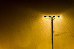 Soft shot of Night Street lamp lights in Heavy rain Royalty Free Stock Images