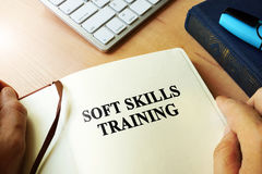 Soft skills training. Hands holding book with title Soft skills training stock images