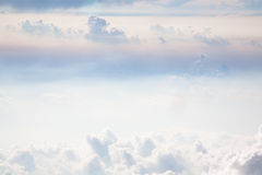 Soft Sky. Soft clouds and colors fill the sky. Image photographed from an airplane at 30,000 feet Stock Images