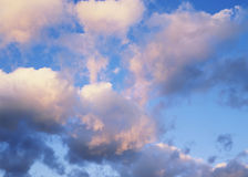 Soft Sky. Close view of beautiful fluffy soft pink clouds float against a blue sky Stock Photography