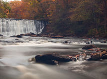 Soft slow moving creek below a dam. Shot with long exposure Royalty Free Stock Photography