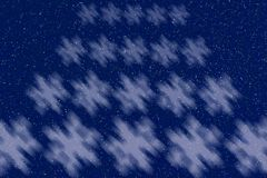 Soft snowflake pattern against a glitter blue night sky backgrou Stock Photography