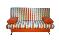 Soft sofa from a fabric in a strip. Stock Photography