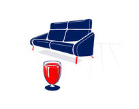 Soft sofa and glass of red wine Royalty Free Stock Image