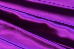 Soft Stripes of Ultra Violet Purple Satin Fabric. Beautiful closeup of gathered stripes of ultra violet purple bridesmaid gown prom dress; dressy fancy soft Royalty Free Stock Photography