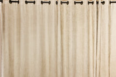 Ring-top Rail Curtain. Soft suede beige block-out curtain drop, with ring-top rail Royalty Free Stock Photography