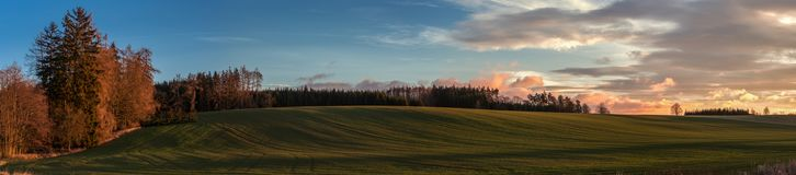 Soft sunrise light in the highland field panorama royalty free stock photography