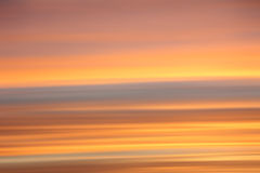 Soft sunset sky background. Striped in shades of orange and grey royalty free stock image