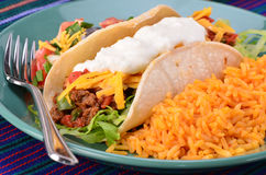 Soft taco. Soft tortilla with spicy ground beef, salsa , sour cream and cheese with Mexican rice Royalty Free Stock Photography