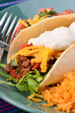 Soft taco. Soft tortilla with spicy ground beef, salsa , sour cream and cheese with Mexican rice Royalty Free Stock Images