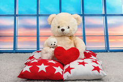 Soft Teddy bear with a heart.Soft beautiful decorative pillows for interior decoration in the house. sitting on the pillow on the. Teddy bears.Gifts and stock image