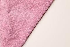 Soft  terry pink towel as background stock images