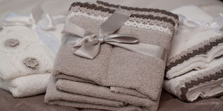 Soft terry towels. With laces tied with ribbons Stock Photo