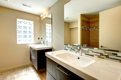 Soft tones bathroom with decorative wall Royalty Free Stock Image