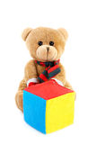 Soft toy a bear with cube  on  white Royalty Free Stock Photo