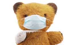 Soft toy bear with flu mask Royalty Free Stock Images
