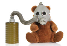 Soft toy bear with gas mask Royalty Free Stock Photography