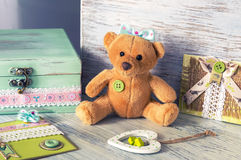 Soft toy bear with a heart and homemade cards. Still life with toys Royalty Free Stock Photo
