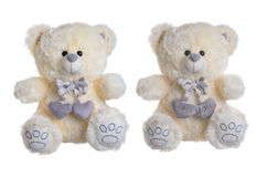Soft toy bear with hearts on a white background Stock Photos