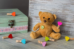 Soft toy bear with multi-colored toys. Festive Greeting Card for Valentine`s Day. Royalty Free Stock Image